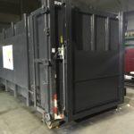 Fabrication et pose de deux portes hydrauliques sur des bennes.